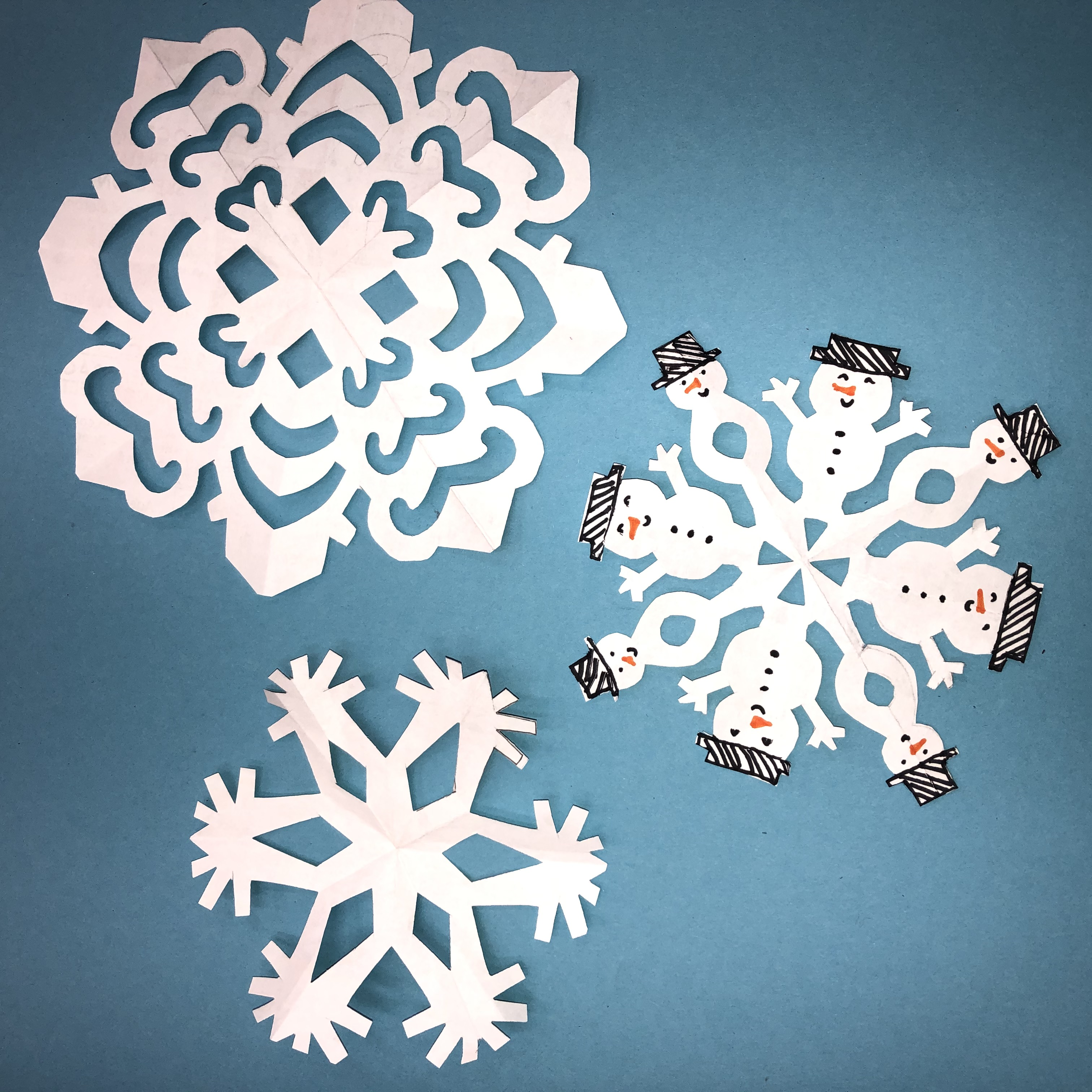 Image of cut paper snowflakes
