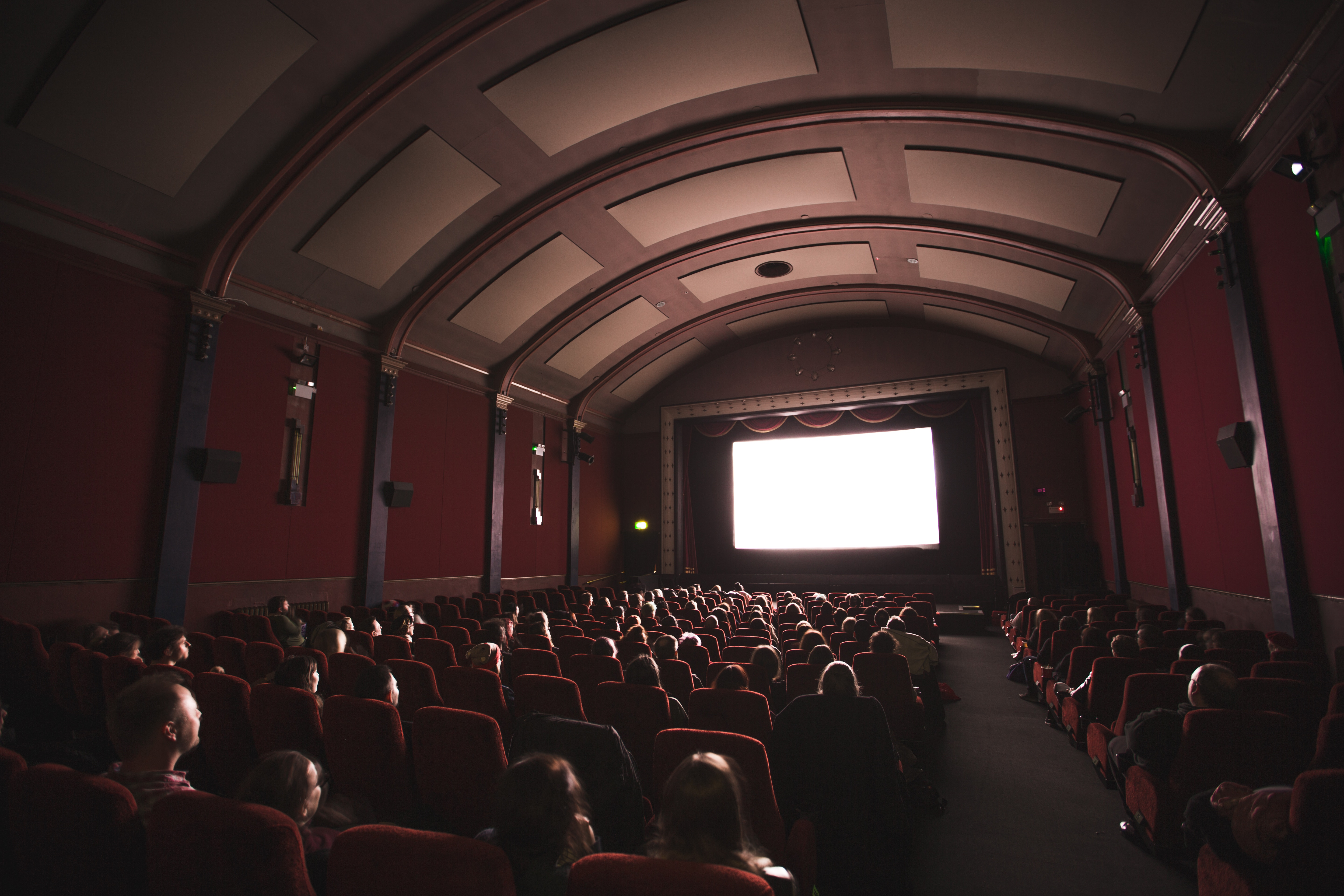 Movie theater with people sitting