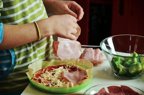 Kid's hands preparing food
